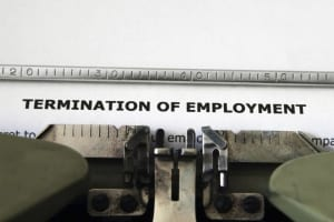 Typewriter with 'Termination of Employment' on it