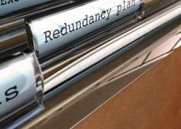 Filing cabinet with 'redundancy plan' in it