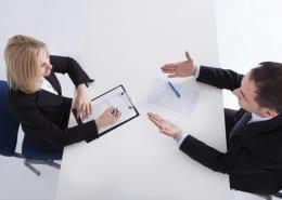 A conversation across a desk