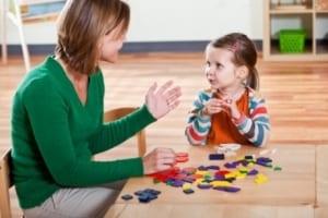 Image of a nursery teacher with a child